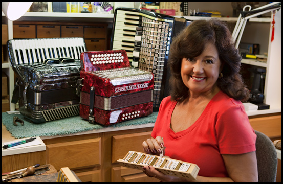 Accordion Rose in her Accordion Repair Studio